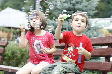 children playing with soap balloons