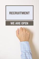 Businessman knocking on Recruitment department office door
