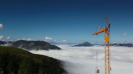 Construction crane in the high mountain