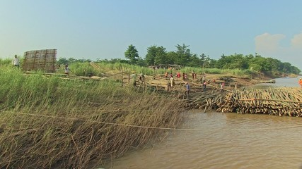 Workers works on the construction bamboo site