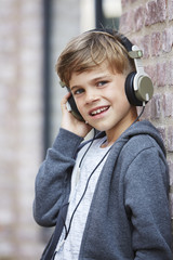 Young boy wearing headphones, close up.