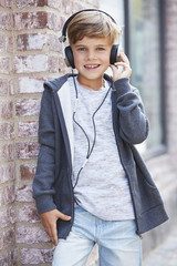 Young boy wearing headphones, portrait.