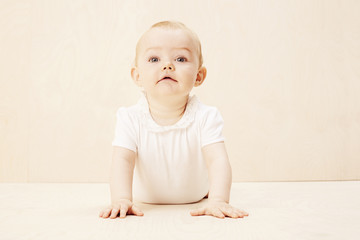 Baby girl looking up, studio shot.