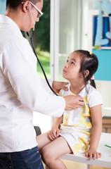 Asian doctor examining girl