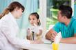 Asian family at pediatrician's office