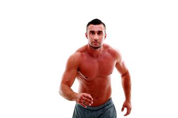 Portrait of muscular man athlete doing running exercise