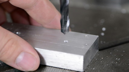 Drilling into a piece of Metal (close-up video)