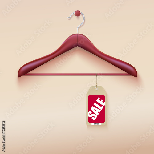 Red tag with sale sign hanging on wooden hanger - 70293812