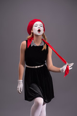 Portrait of young mime girl with white face