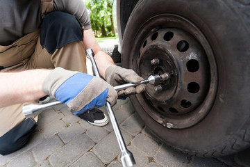 Man screwing car wheel