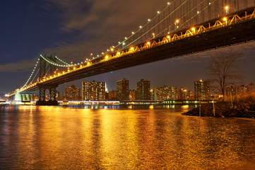 Manhattan Bridge and skyline view from Brooklyn at night