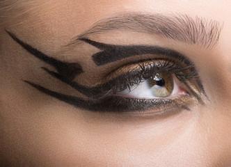 Closeup shot of woman eye with futuristic makeup