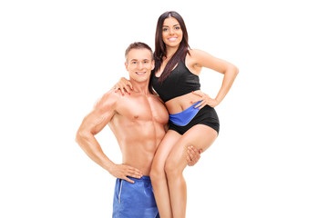 Handsome man lifting his girlfriend