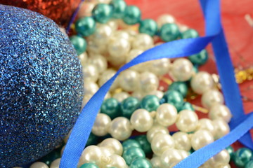 Christmas background with blue and white pearls