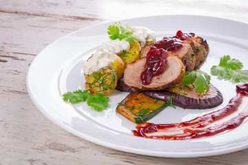 Roasted duck breast with cranberry sauce and vegetables