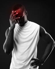 Frustrated african man over black background