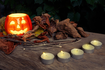 Halloween background with ceramic pumpkin, autumn leaves and sma