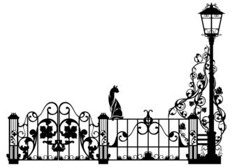 cat watching bird sitting on garden fence