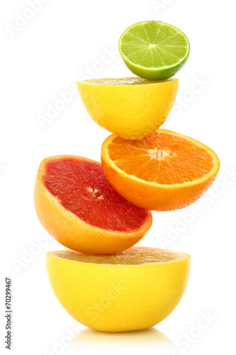 Fotobehang Vruchten Fresh citrus fruit in a row on white background