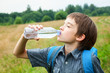 Kid drink water oudoors