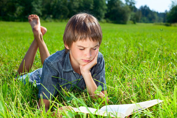 Child reading book outdoor