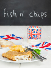 fish and chips with a cup of tea  bread and butter and union jac
