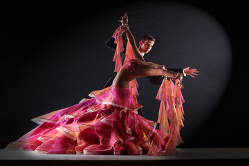 Latino dancers in ballroom isolated on black background