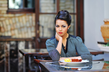 Young business woman on lunch break in cafe or restaurant sittin