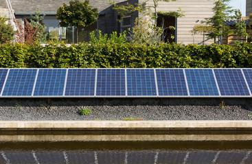 Solar panels in a garden of a modern house.