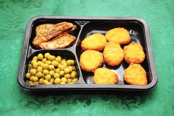 Chicken Nugget Tv Dinner Over a Green Background