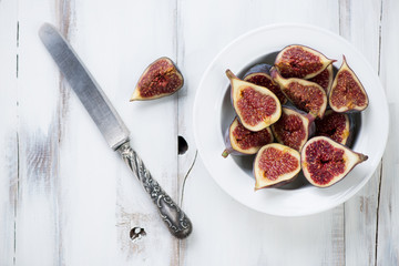 Ripe sliced figs in a glass plate, horizontal shot, above view