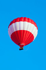 Red Hot Air Balloon against a clear blue sky