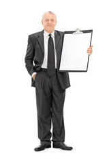 Mature businessman holding a huge clipboard