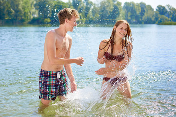 Girl and Boy splashing
