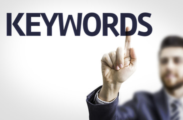 Business man pointing the text: Keywords