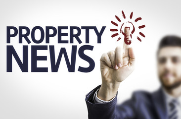 Business man pointing the text: Property News