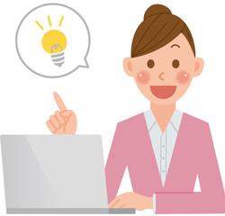 パソコンをする女性 電球