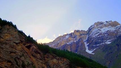 snow rocky mountain at sun dawn