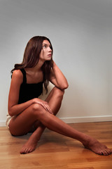 Lonely young woman gazing with sad expression