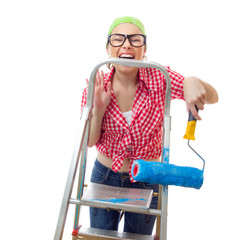 Expressive woman holding roller afore ladder