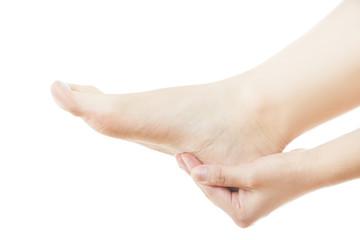 Massage of female feet isolated on white background