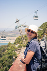 Happy woman tourist at Gibraltar Rock