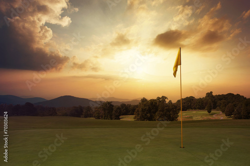 Mountain sunrise at the golf course - 70303624