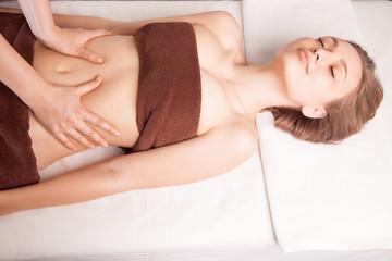 Woman enjoying Ayurveda oil massage in spa
