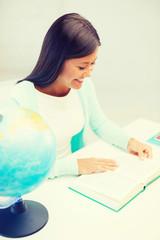 female teacher with globe and book