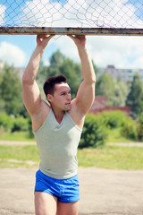 Workout, street sport - concept. Handsome man posing summer