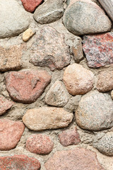 Round brown stone wall background. Outdoors.