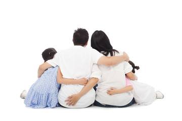 asian happy family sitting on floor . isolated on white