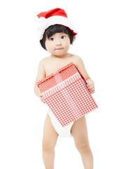 cute  baby in Santa cap holding a gift box
