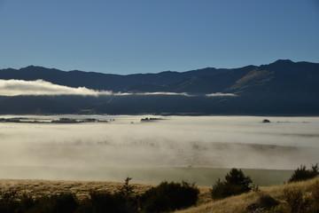 Morning foggy landscape between Wanaka and Hawea, South Island